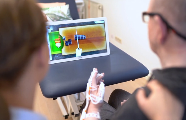 Patients with Neofect Smart Gloves and Focusing on Games