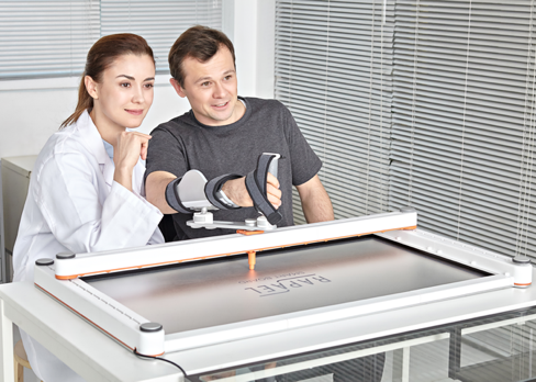 A therapist and patient immersed in the Neofect Smartboard game.